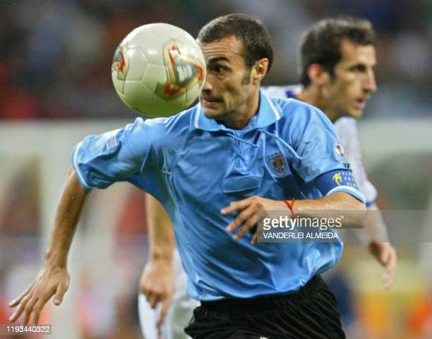 Paolo Montero of Uruguay chases the ball as Johan Micoud of France follows, 06 June 2002 at the Busan Asiad Main Stadium in Busan, during first round...