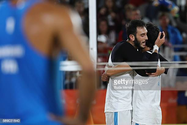 Paolo Nicolai and Daniele Lupo of Italy celebrate victory in the Men's Round of 16 match against Alex Ranghieri and Adrian Ignacio Carambula Raurich...