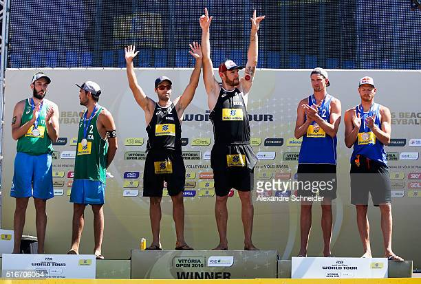 Paolo Nicolai and Daniele Lupo of Italy silver medal Bruno Schmidt and Alison Ceruti of Brazil show the gold medal and Alexander Brouwer and Robert...