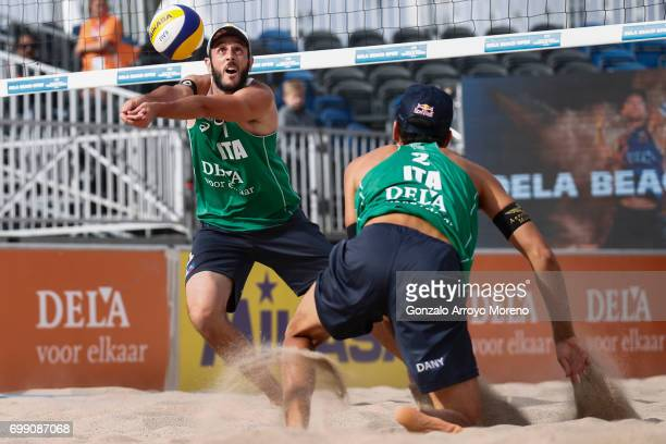 Paolo Nicolai from Italy bumps the ball behind his partner Daniele Lupo during their match against Belgium during the FIVB Beach Volleyball World...
