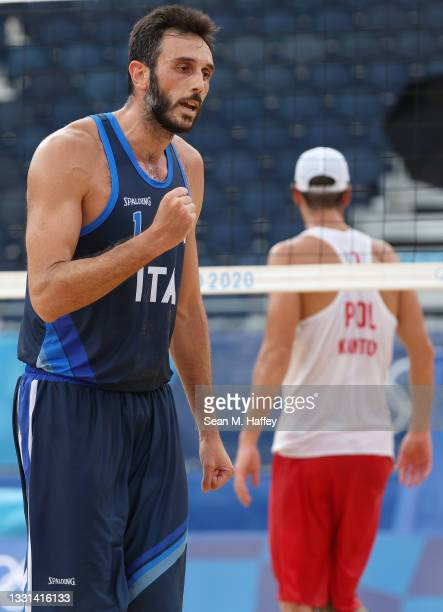 Paolo Nicolai of Team Italy reacts after defeating Team Poland during the Men's Preliminary - Pool F beach volleyball on day seven of the Tokyo 2020...