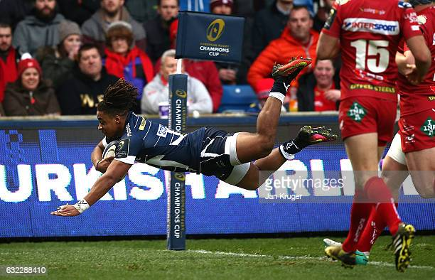 Paolo Odogwu of Sale Sharks dives over the line for his try during the European Rugby Champions Cup match between Sale Sharks and Scarlets at AJ Bell...