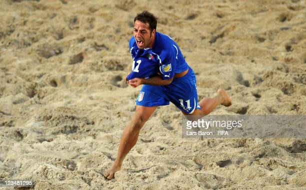Paolo Palmacci of Italy celebrates after scoring a goal during the FIFA Beach Soccer World Cup Group A match between Senegal and Italy at Stadium del...