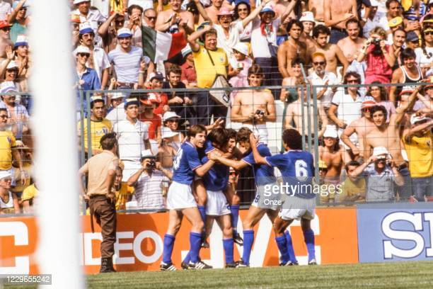 Paolo Rossi of Italy celebrate his goal during the second stage of the 1982 FIFA World Cup match between Italy and Brazil, at Sarria Stadium,...