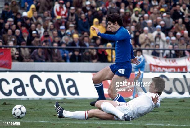 Paolo Rossi of Italy is tackled by a Hungarian defender during the Italy v Hungary World Cup match in Mar del Plata Argentina on 6th June 1978 Italy...