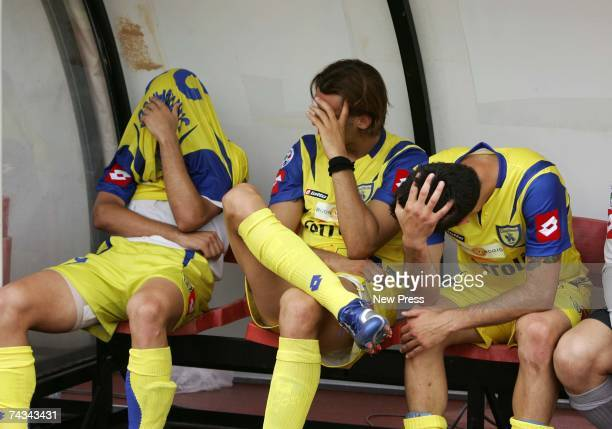 Paolo Sammarco Cesare Rickler and Marco Malago of Chievo Verona look dejected having been relegated to Serie B after the Serie A match between...
