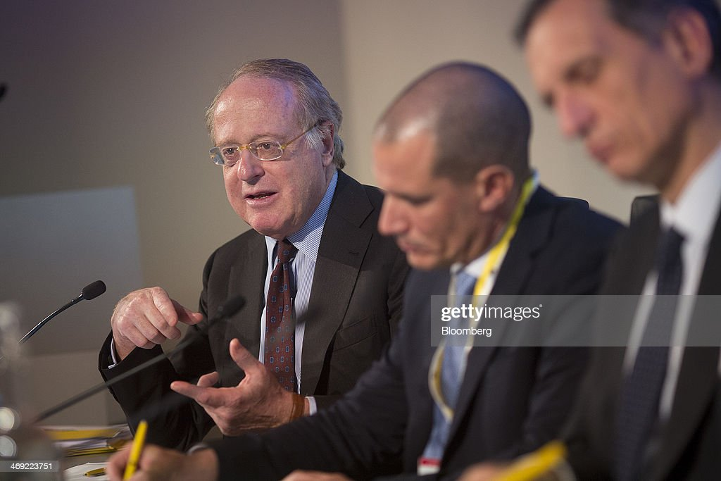 Paolo Scaroni, chief executive officer of Eni SpA, left, speaks as Roberto Albini, the company's press officer, center, and Giuseppe Recchi, chairman of Eni SpA, listen during a news conference following the company's 2014-2017 strategy presentation in London, U.K., on Thursday, Feb. 13, 2014. Eni SpA, Italy's biggest oil company, said profit slumped 14 percent in the fourth quarter due to production halts in Libya and Nigeria and shrinking refining margins. Photographer: Simon Dawson/Bloomberg via Getty Images