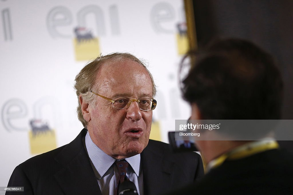 Paolo Scaroni, chief executive officer of Eni SpA, left, speaks to journalists ahead of a news conference in London, U.K., on Thursday, Feb. 13, 2014. Eni SpA, Italy's biggest oil company, said profit slumped 14 percent in the fourth quarter due to production halts in Libya and Nigeria and shrinking refining margins. Photographer: Simon Dawson/Bloomberg via Getty Images
