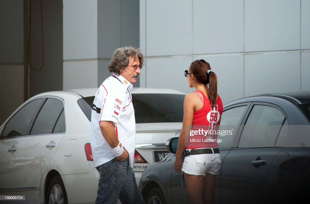 Paolo Simoncelli, father of Marco Simoncelli of Italy and San Carlo Honda Gresini, speaks with the rider's fiancee Kate Fretti at a medical facility after the MotoGP of Malaysia was stopped following the fatal crash of his son at Sepang Circuit on October 23, 2011 in Kuala Lumpur, Malaysia. 24-year-old Italian MotoGP rider Marco Simoncelli has died following a crash involving Valentino Rossi and Colin Edwards during the Malaysian MotoGP in Sepang, Malaysia.