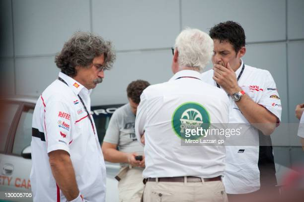 Paolo Simoncelli father of Marco Simoncelli of Italy and San Carlo Honda Gresini and and Fabrizio Cecchini at a medical facility after the MotoGP of...
