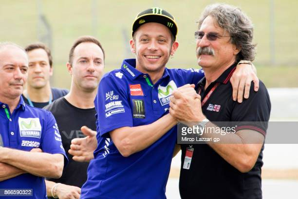 "Paolo Simoncelli of Italy hugs Valentino Rossi of Italy and Movistar Yamaha MotoGP during the ""Track walk to Turn 11 for SIC "" ahead of the MotoGP of..."