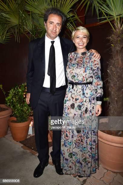 Paolo Sorrentino and Daniela D'Antonio attend Fondazione Prada Private Dinner during the 70th annual Cannes Film Festival at Restaurant Fred...