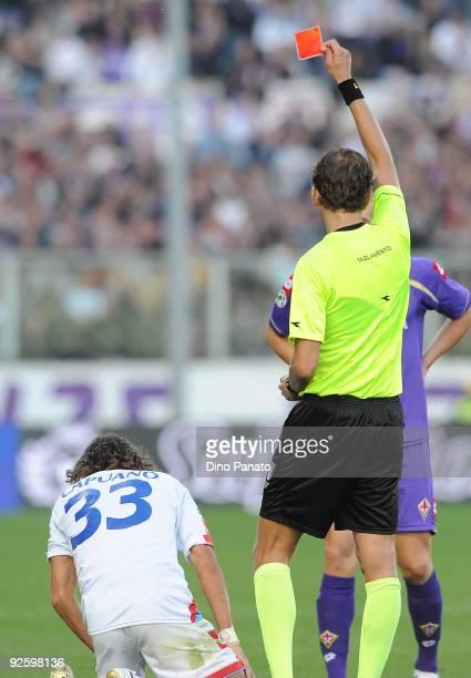 Paolo Tagliavento referee shows the red card on Ciro Capuano of Catania Calcio during the Serie A match between ACF Fiorentina and Catania Calcio at...