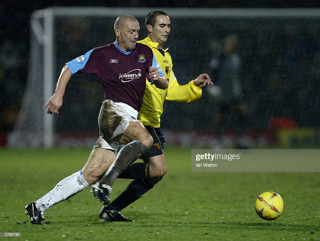 Paolo Vernazza of Watford tries to tackle Tomas Repka of West Ham during the Nationwide Division One match between Watford and West Ham United at Vicarage Road on November 22 in Watford, England.