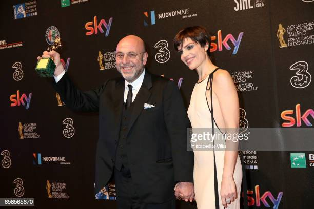 Paolo Virzi and Micaela Ramazzotti pose with the Best Movie Award for 'La Pazza Gioia' during the 61 David Di Donatello ceremony on March 27 2017 in...
