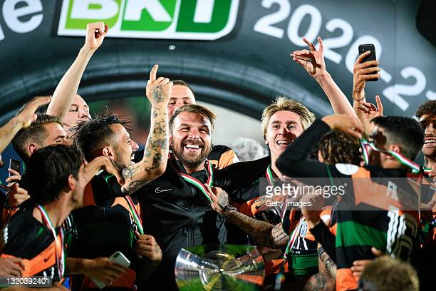 Paolo Zanetti head coach of Venezia FC celebrates being promoted to Serie A with his players after the Serie B Playoffs Final match between Venezia...