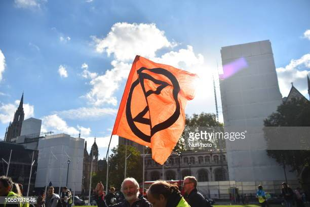 Paople gather at Parliament Square to protest against fracking and more i general to rise awareness of climate change London on October 31 2018 The...