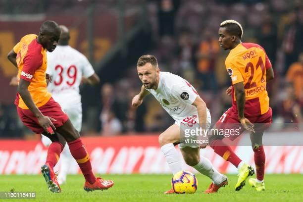 Papa Alioune Badou Ndiaye of Galatasaray SK Hakan Ozmert of Antalyaspor AS Henry Onyekuru of Galatasaray SK during the Turkish Spor Toto Super Lig...