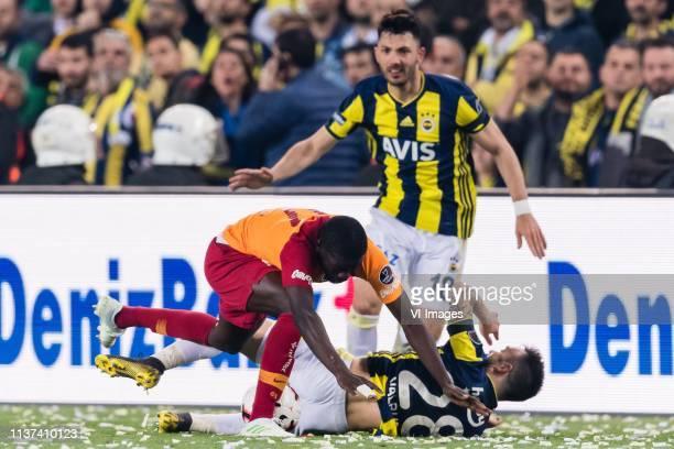 Papa Alioune Badou Ndiaye of Galatasaray SK, Mathieu Valbuena of Fenerbahce SK, Tolgay Arslan of Fenerbahce SK during the Turkish Spor Toto Super Lig...