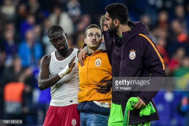 Papa Alioune Ndiaye of Galatasaray and Ismail Cipe of Galatasaray speak with a supporter during the Group D match of the UEFA Champions League...