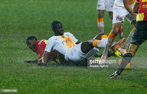 Papa Alioune Ndiaye of Galatasaray in action against Andre Poko of Goztepe during the Turkish Super Lig soccer match between Goztepe and Galatasaray...