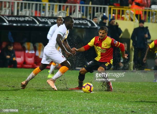 Papa Alioune Ndiaye of Galatasaray in action against Celso Borges of Goztepe during the Turkish Super Lig soccer match between Goztepe and...