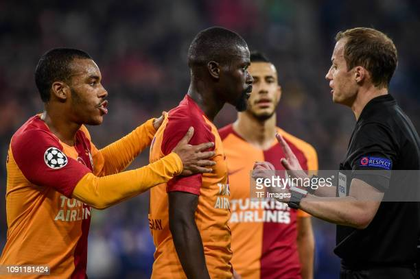 Papa Alioune Ndiaye of Galatasaray, referee William Collum and Garry Rodrigues of Galatasaray discuss during the Group D match of the UEFA Champions...