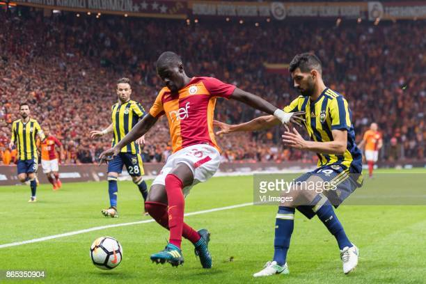 Papa Alioune N'Diaye of Galatasaray SK Luis Carlos Novo Neto of Fenerbahce SK during the Turkish Spor Toto Super Lig football match between...