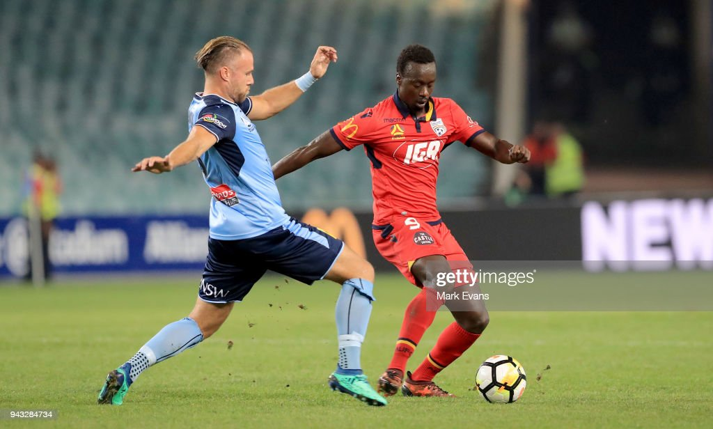 Papa Baba Diawara (R) of Adelaide United is tackled by Jordy Buijs of Sydney FC during the round 26 A-League match between Sydney FC and Adelaide United at Allianz Stadium on April 8, 2018 in Sydney, Australia.