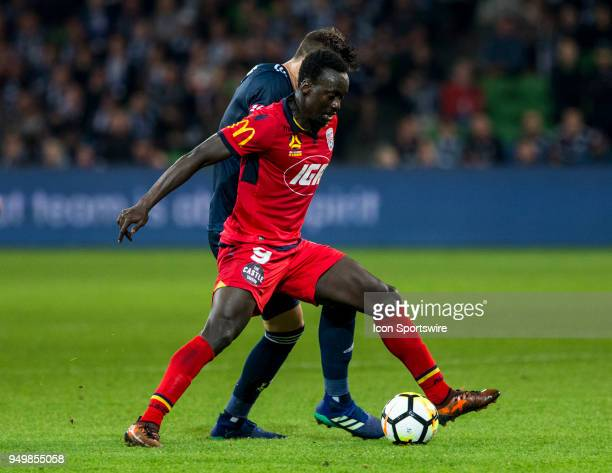 Papa Babacar Diawara of Adelaide United and James Donachie of Melbourne Victory contest the ball during the Elimination Final of the Hyundai ALeague...