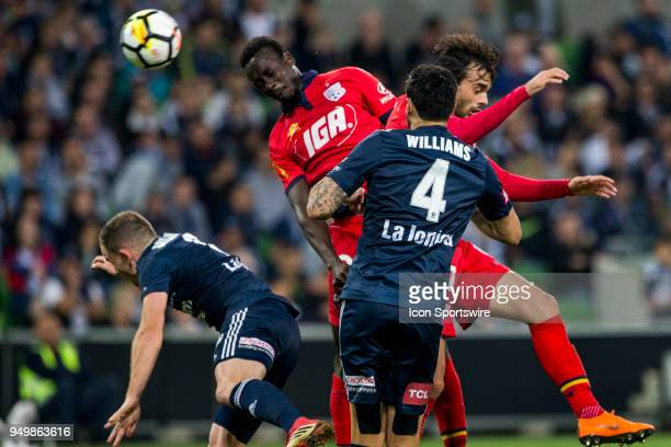 Papa Babacar Diawara of Adelaide United heads the ball amounts a pack of other players during the Elimination Final of the Hyundai ALeague Series...