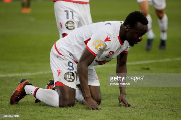 Papa Babacar of Adelaide United celebrates scoring during the round 27 ALeague match between the Western Sydney Wanderers and Adelaide United at ANZ...