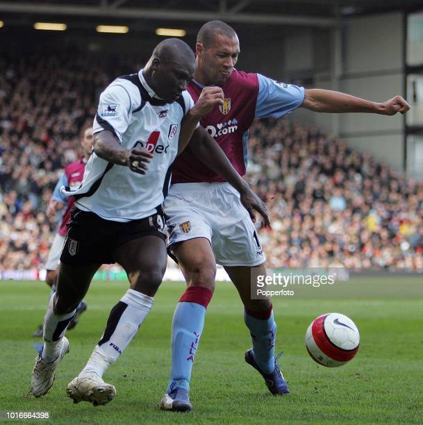Papa Bouba Diop of Fulham and John Carew of Aston Villa in action during the Barclays Premiership match between Fulham and Aston Villa at Craven...