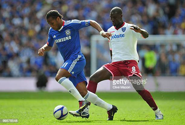 Papa Bouba Diop of Portsmouth challenges Didier Drogba of Chelsea during the FA Cup sponsored by EON Final match between Chelsea and Portsmouth at...