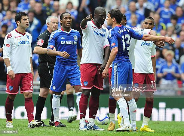 Papa Bouba Diop of Portsmouth clashes with Michael Ballack of Chelsea during the FA Cup sponsored by EON Final match between Chelsea and Portsmouth...