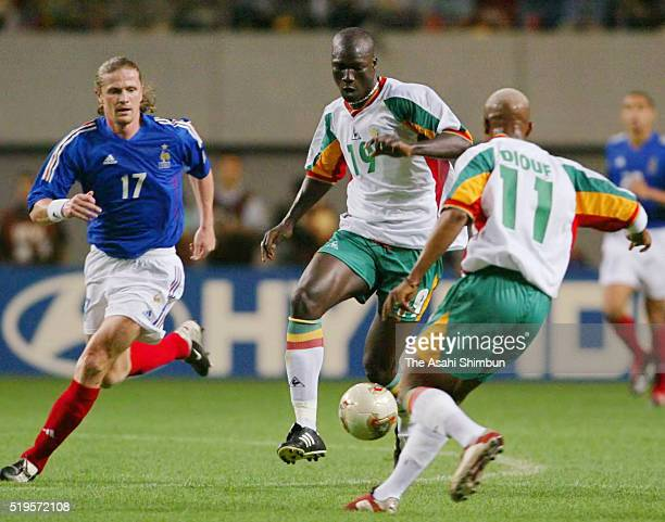 Papa Bouba Diop of Senegal and Emmanuel Petit of France compete for the ball during the FIFA World Cup Korea/Japan Group A match between France and...