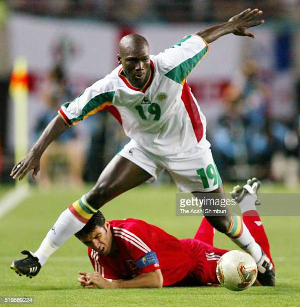 Papa Bouba Diop of Senegal and Hakan Sukur of Turkey compete for the ball during the FIFA World Cup Korea/Japan quarter final match between Senegal...
