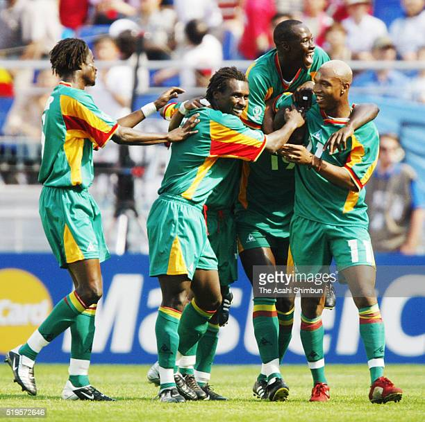 Papa Bouba Diop of Senegal celebrates scoring his team's third goal with his team mates during the FIFA World Cup Korea/Japan on June 1 2002 in Tokyo...