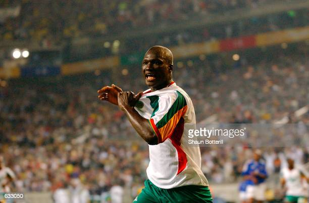 Papa Bouba Diop of Senegal celebrates scoring the winning goal against France during the first half of the France v Senegal Group A World Cup Group...