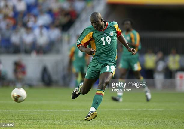 Papa Bouba Diop of Senegal charges forward during the FIFA World Cup Finals 2002 Group A match between Uruguay and Senegal played at the Suwon World...