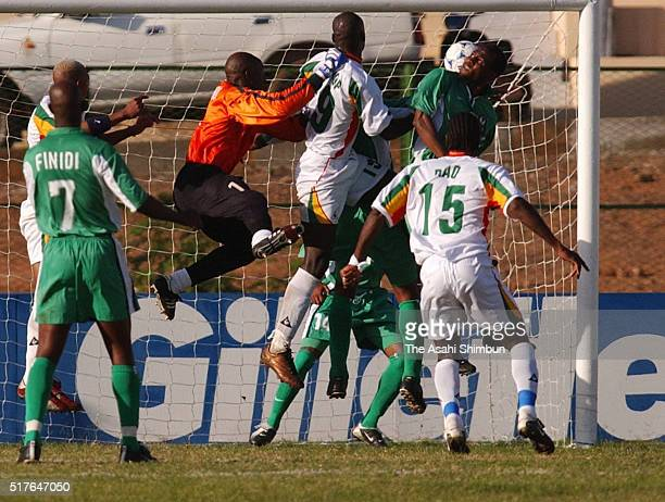 Papa Bouba Diop of Senegal scores his team's first goal during the Africa Cup of Nations semi final match between Nigeria and Senegal at the Stade...