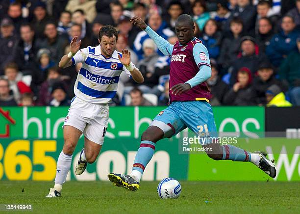 Papa Bouba Diop of West Ham is put under pressure by Noel Hunt of Reading during the npower Championship match between Reading and West Ham United at...