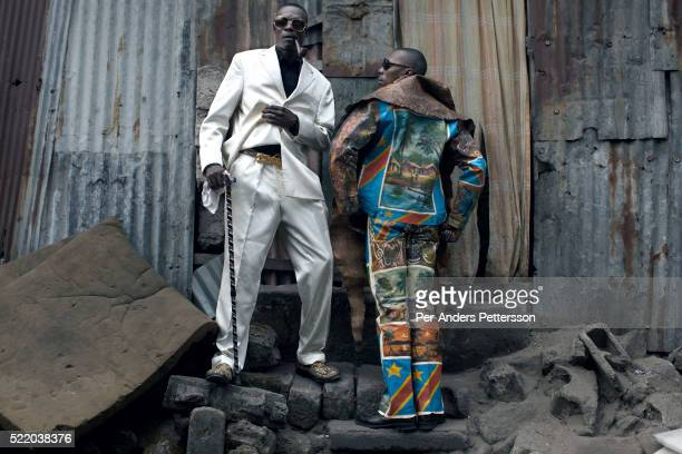 Papa Griffe , a senior and a leader of the Sapeurs poses for pictures with his brother Jika in the Mombele area where they live area on February 12,...