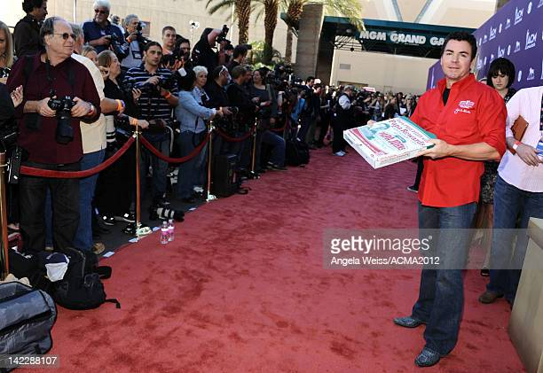Papa John's Pizza CEO John Schnatter arrives at the 47th Annual Academy Of Country Music Awards held at the MGM Grand Garden Arena on April 1 2012 in...