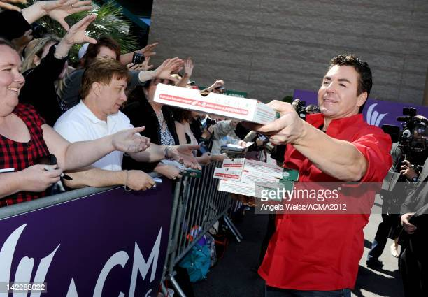 Papa John's Pizza CEO John Schnatter hands out pizza as he arrives at the 47th Annual Academy Of Country Music Awards held at the MGM Grand Garden...