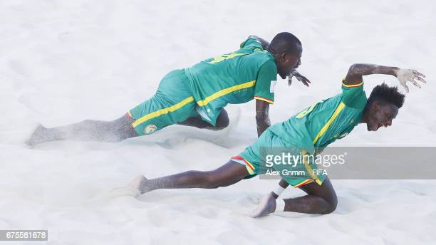 Papa Ndour of Senegal celebrates a goal with team mate Hamad Diouf during the FIFA Beach Soccer World Cup Bahamas 2017 group A match between...