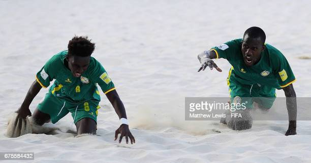 Papa Ndour of Senegal celebrates his goal with Papa Ndoye during the FIFA Beach Soccer World Cup Bahamas 2017 group A match between Switzerland and...