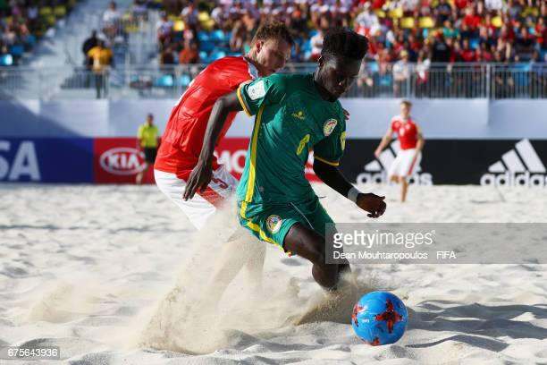 Papa Ndoye of Senegal battles for the ball with Michael Misev of Switzerland during the FIFA Beach Soccer World Cup Bahamas 2017 group A match...