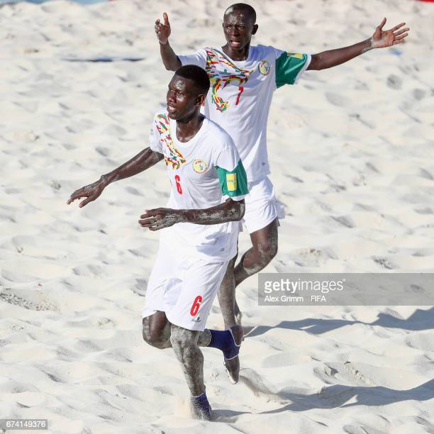 Papa Ndoye of Senegal celebrates a goal with team mate Babacar Fall during the FIFA Beach Soccer World Cup Bahamas 2017 group A match between Ecuador...