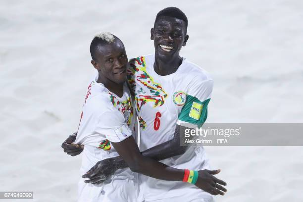 Papa Ndoye of Senegal celebrates a goal with team mate Ibrahima Balde during the FIFA Beach Soccer World Cup Bahamas 2017 group A match between...